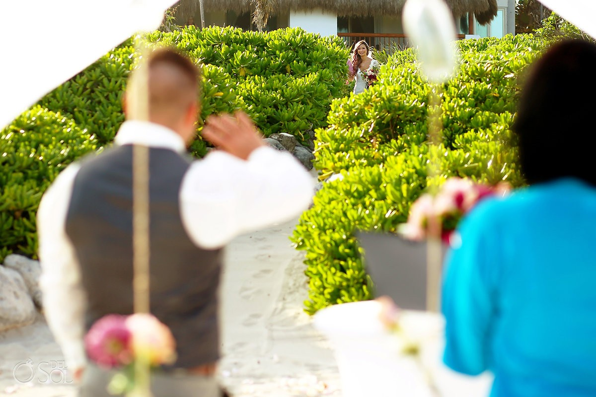 bride entrance groom waves Destination beach wedding Valentin Imperial Maya Playa del Carmen Mexcio