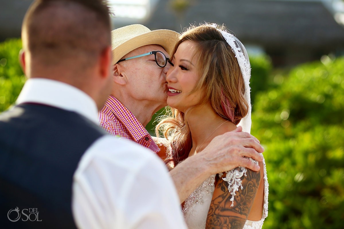 father kisses bride, emotional beach ceremony moment, destination wedding Valentin Imperial Maya