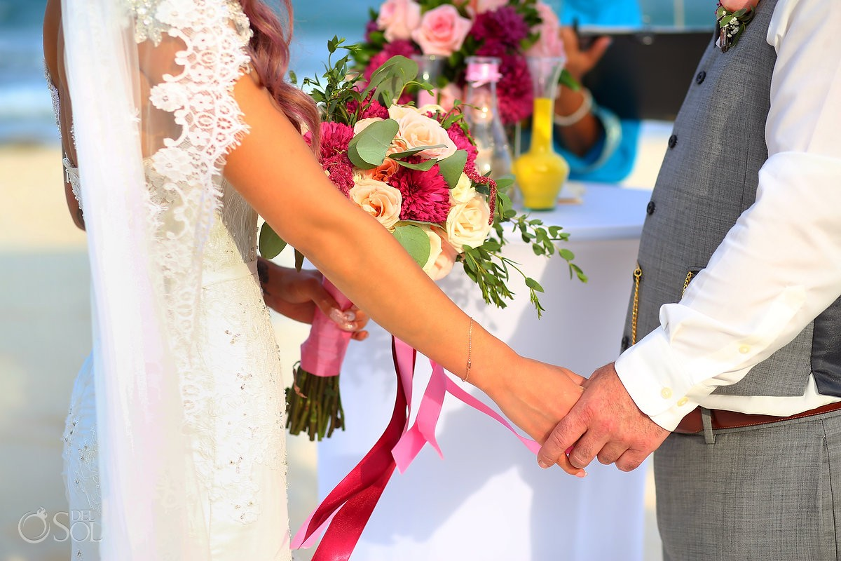 Mexican vibe colorful destination wedding hands bouquet detail, beach ceremony Valentin Imperial Maya