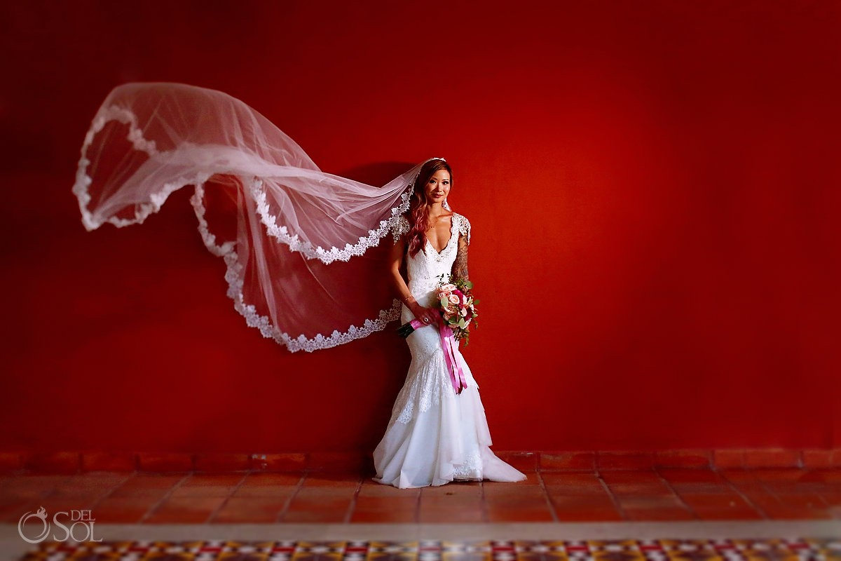 Mexican vibe style, destination wedding bride bridal portrait flying veil red wall, Valentin Imperial Maya