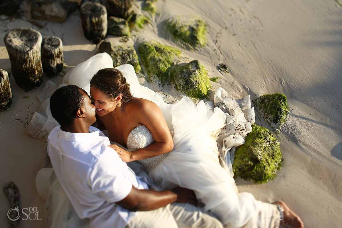 Sunrise romantic wedding portrait trash the dress Puerto Morellos pier, Mexico