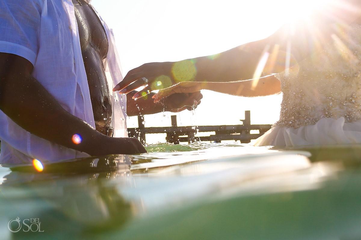 water dripping detail Sunrise wedding portrait beach trash the dress Puerto Morelos pier, Mexico