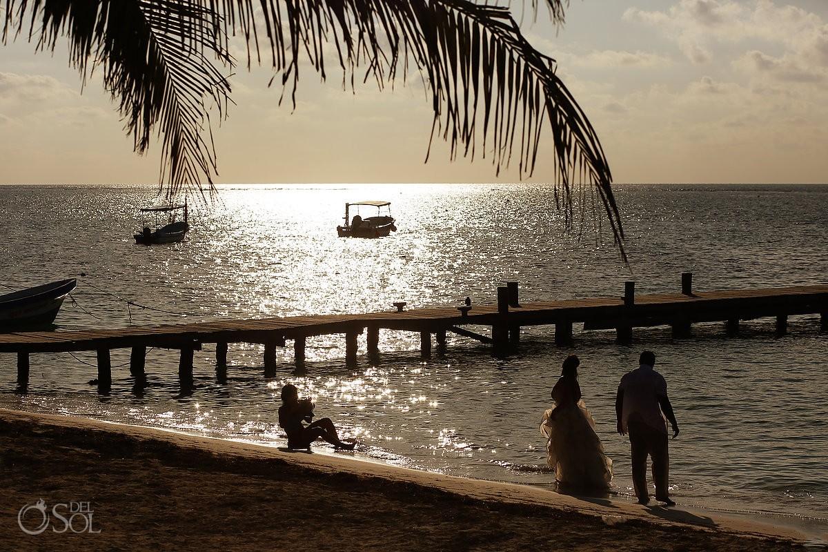 Sunrise wedding portrait beach trash the dress silhouette Puerto Morelos pier, Mexico