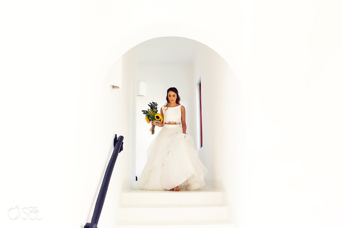 bride coming down stairs for mexico destination wedding