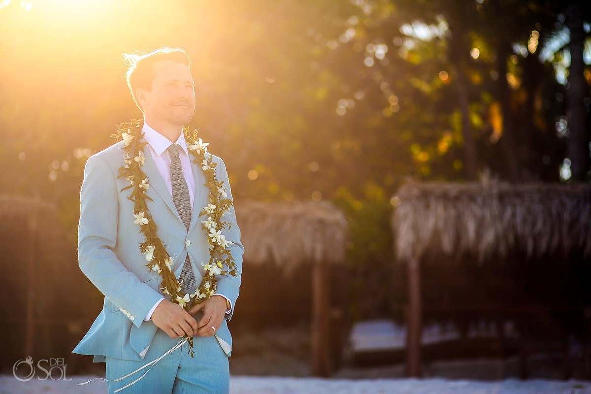 groom wearing turquoise suit and Maile Lei from Hawaiian tradition.