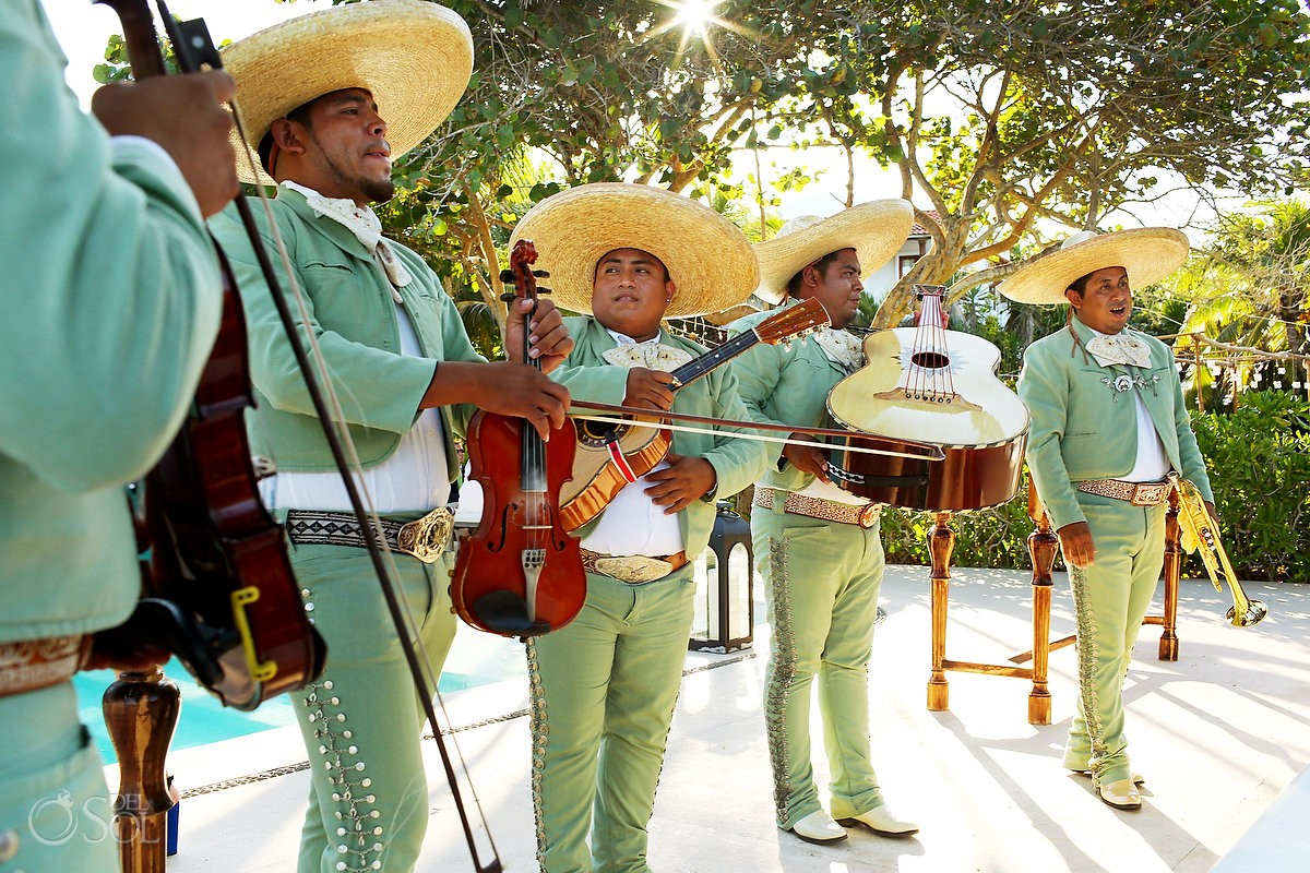 Mariachi group plays famous songs for beach destination wedding in mexico