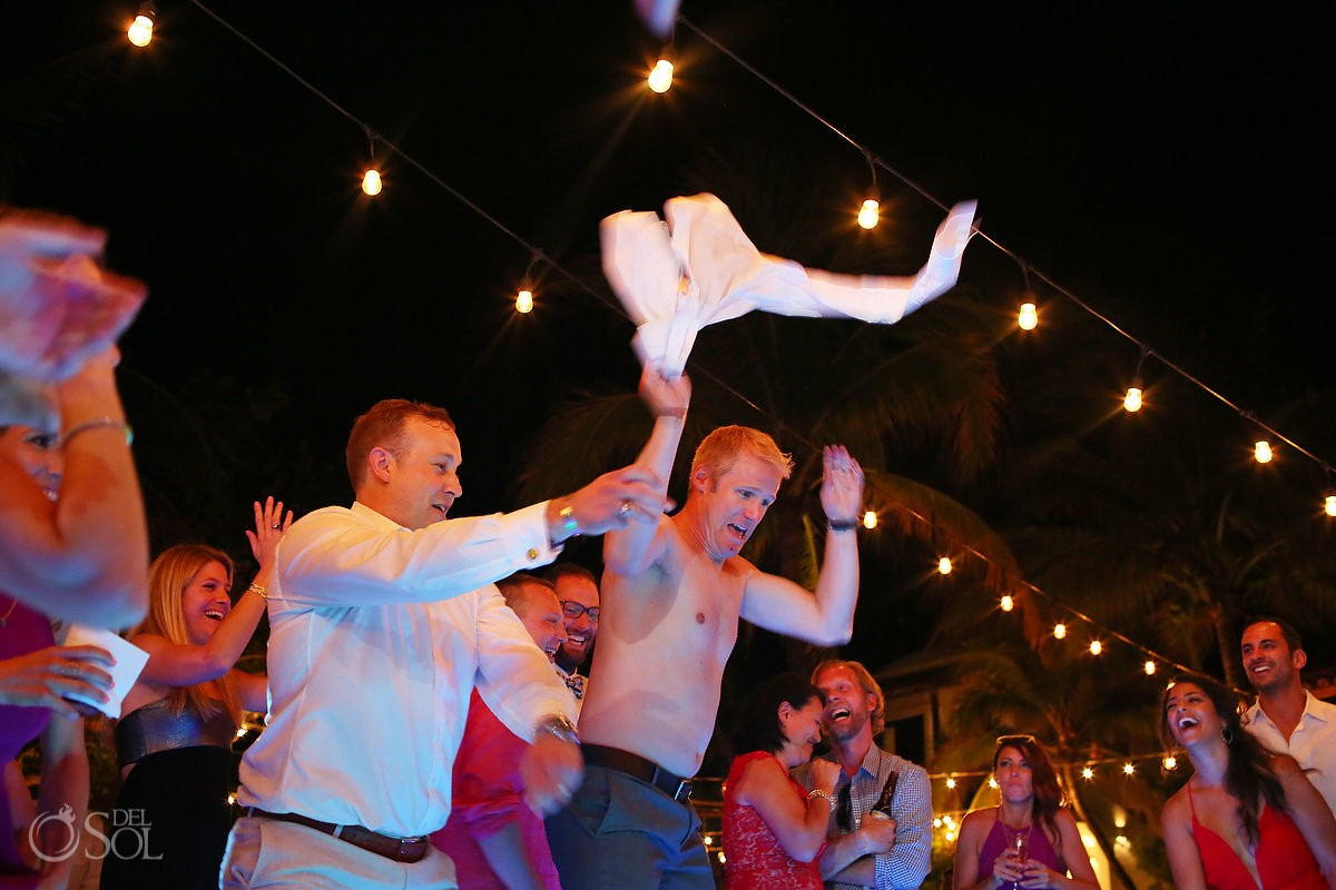wedding guests throw clothing at hotel esencia reception