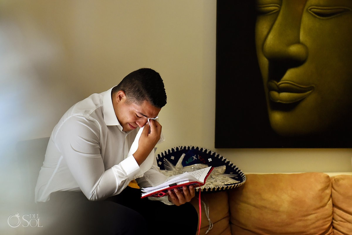 emotional groom crying reading vows from journal, juxtaposition calm Buddha face painting, El Taj Hotel