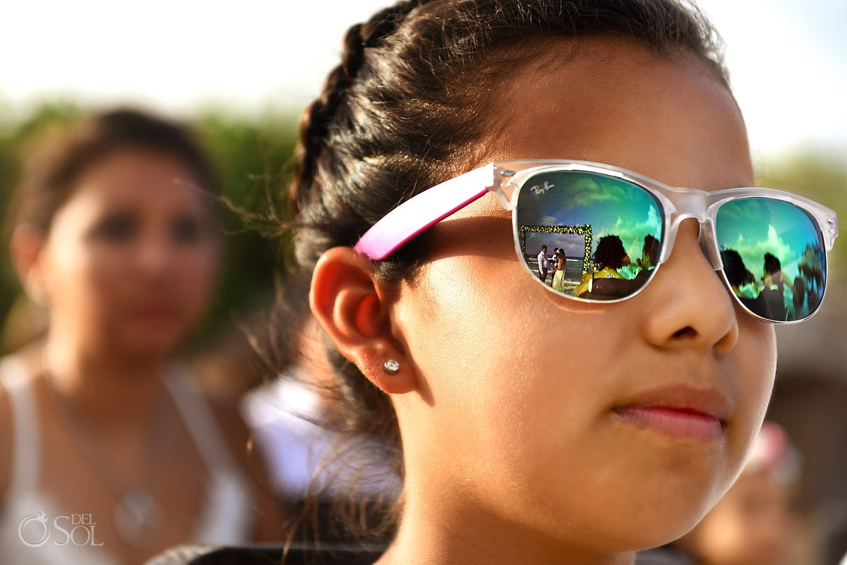Creative wedding ceremony photograph flower girl sunglasses reflection wedding ceremony Blue Venado Beach Club Playa del Carmen
