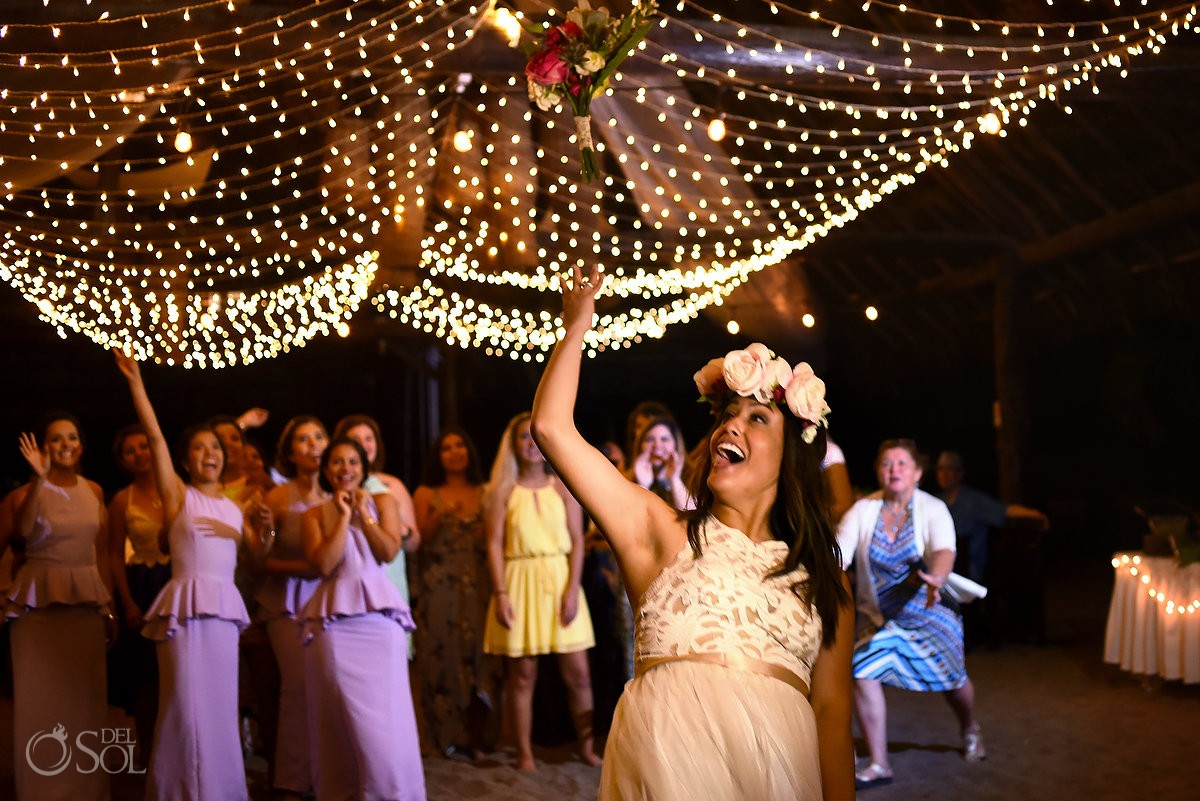 bouquet toss destination wedding reception palapa Blue Venado Beach Club Playa del Carmen