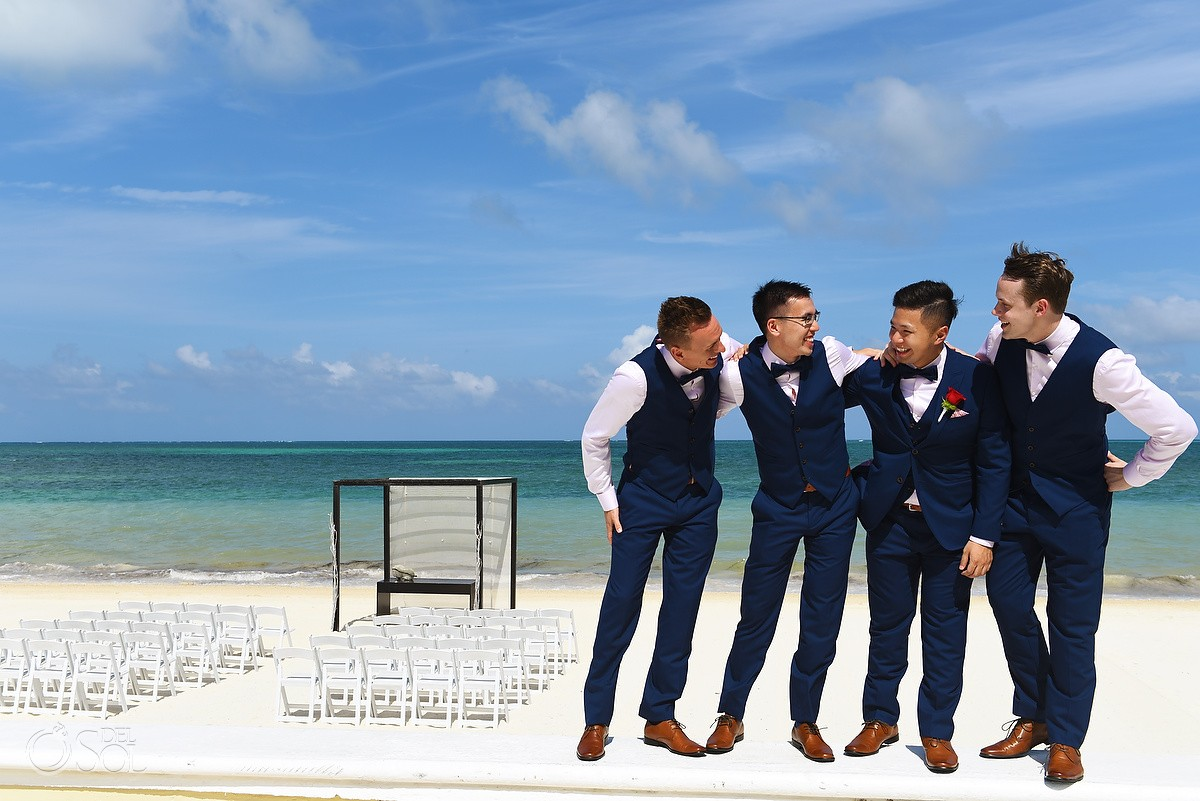 candid bridal party groom groomsmen photo Destination Wedding Moon Palace Beach Cancun Mexico