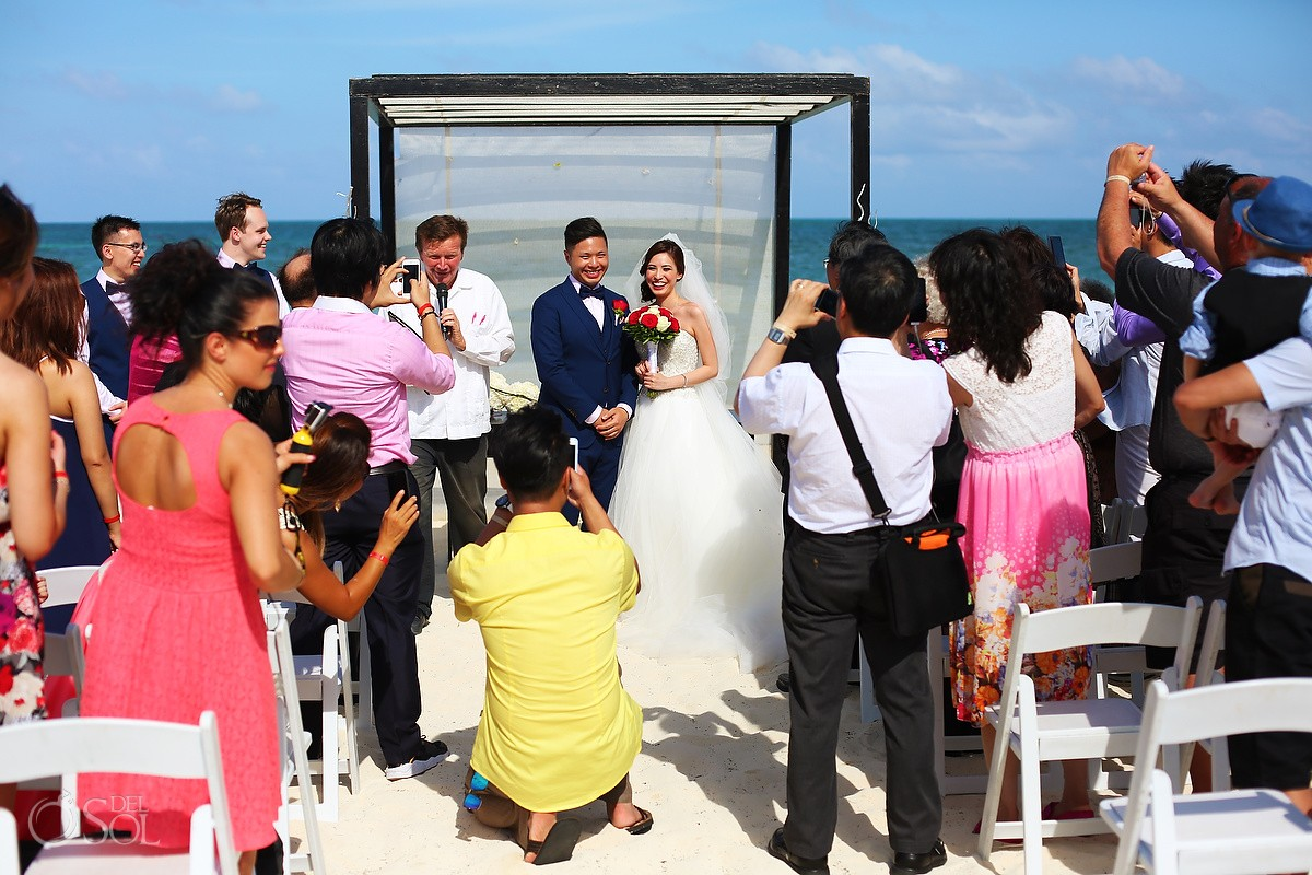 guests taking photos beach Wedding Moon Palace, Cancun, Mexico