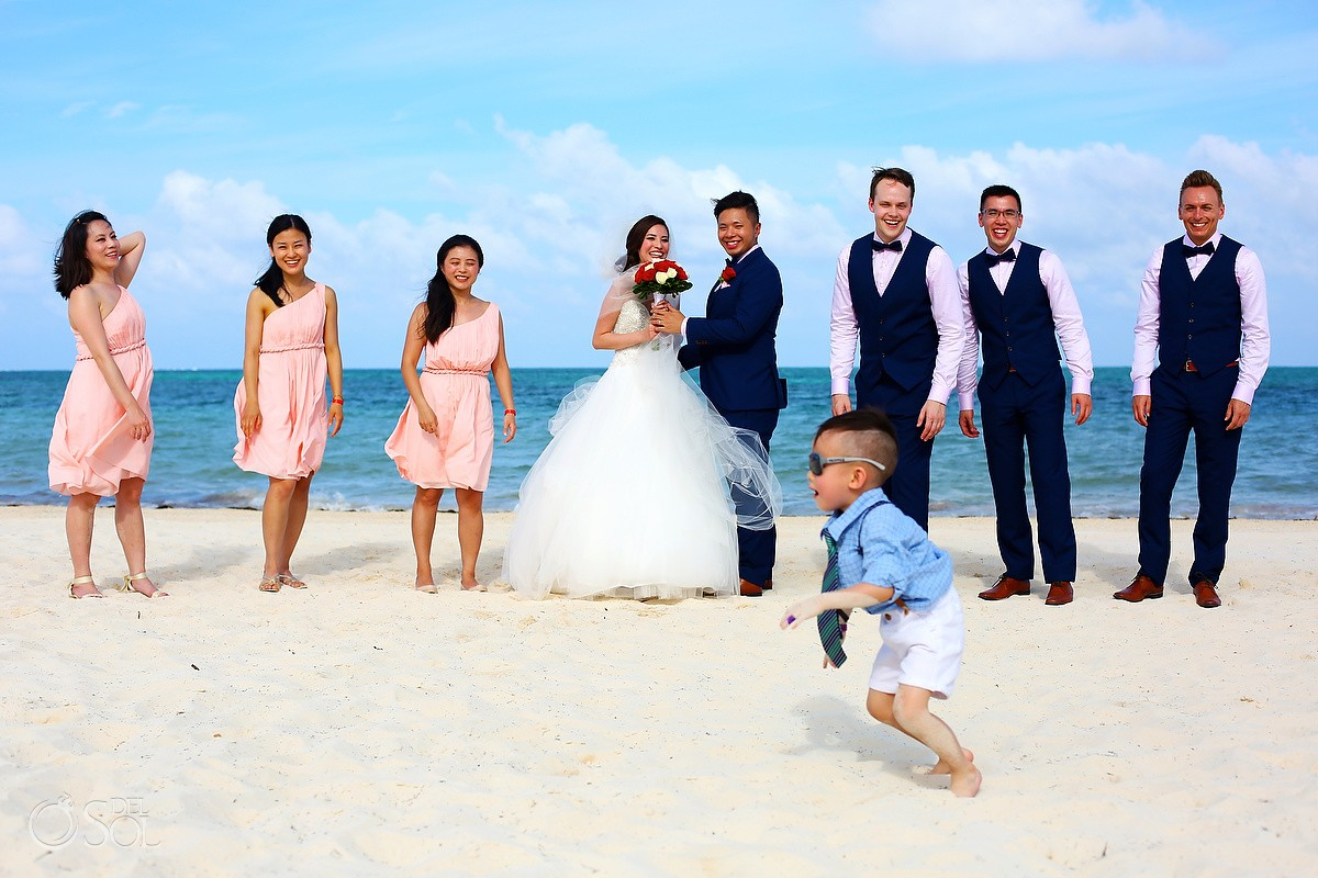 cute kid photobomb bridal party beach Wedding Moon Palace, Cancun, Mexico