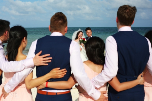creative fun bridal party wedding portrait idea beach Wedding Moon Palace, Cancun, Mexico