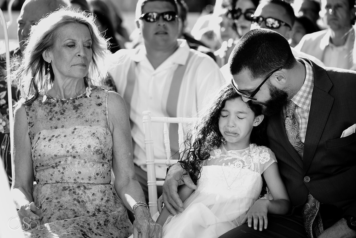 Little girl crying during the ceremony on the beach destination wedding, Playa Del Carmen, Riviera Maya, Mexico