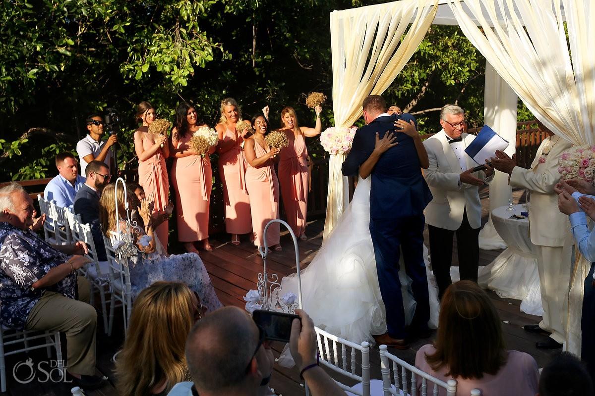 Hugs after wedding ceremony, beach destination wedding, Paradisus La Esmeralda, Riviera Maya, Mexico