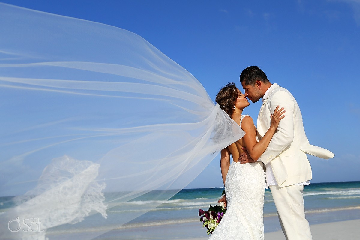 beach destination wedding portrait couple kiss veil flying Casa Maya Kaan, Sian Ka'an, Tulum, Mexico