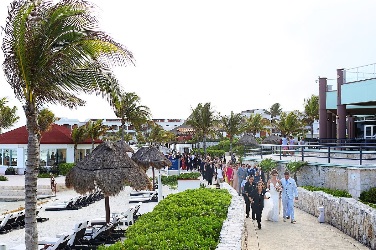 Bride groom guests walking wedding gazebo Hard Rock Hotel Riviera Maya