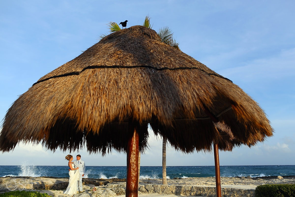 creative frame sunset beach wedding portrait palapa bird Hard Rock Hotel Riviera Maya, Mexico