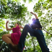 dynamic jumping cenote photo adventure Jungle engagement portraits Riviera Maya Mexico