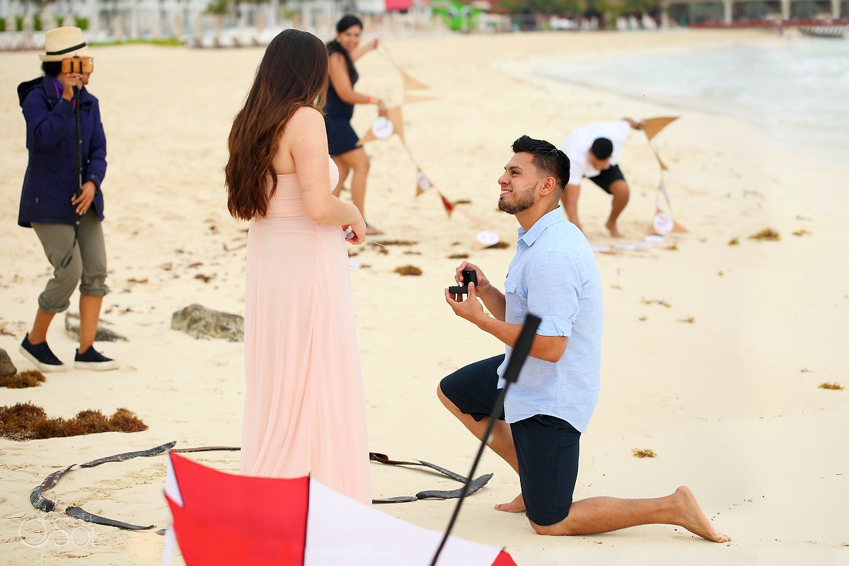 Erick gets down on one knee to propose to his girlfriend in playa del carmen mexico