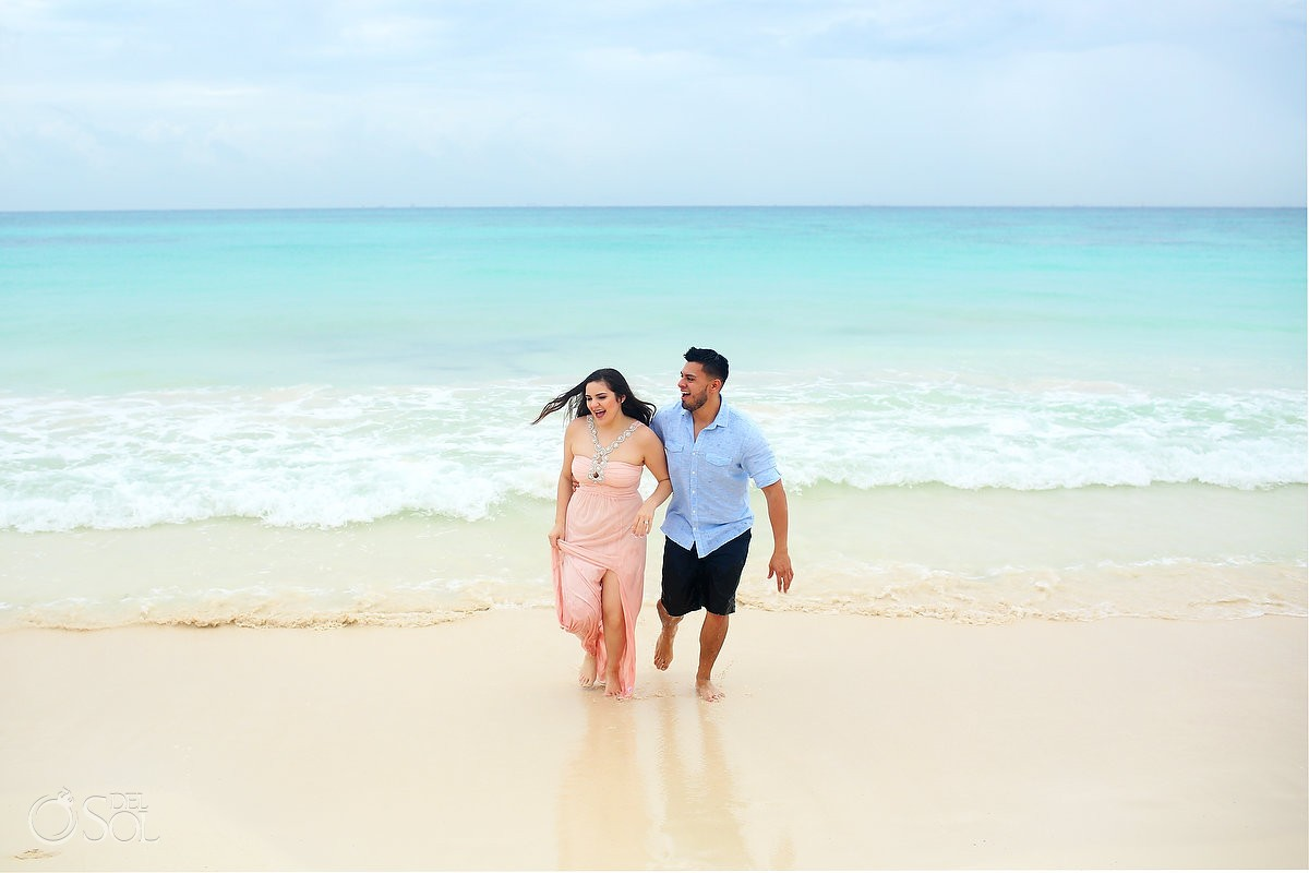 newly engaged couple in the ocean in playa del carmen