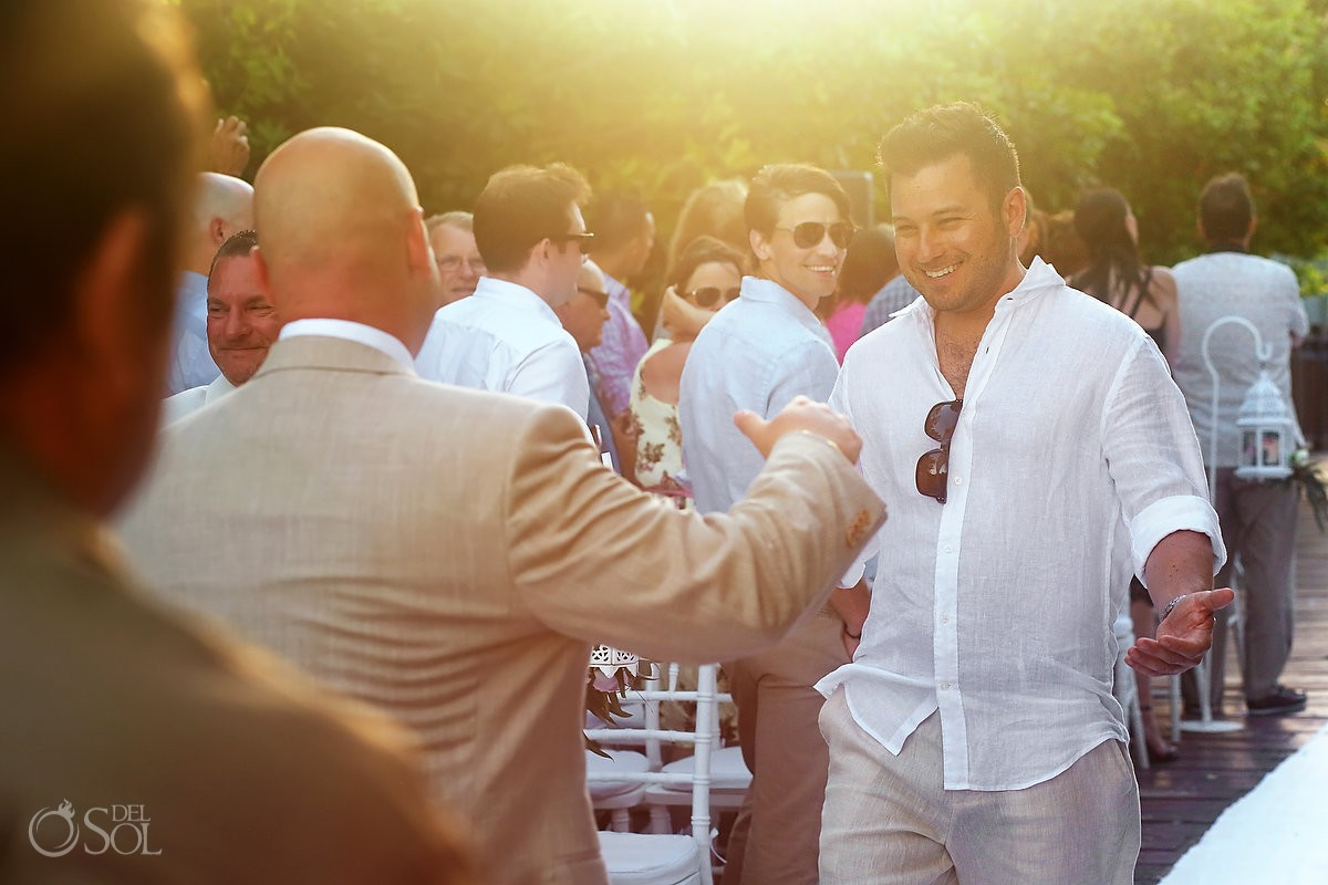 groom greeting guests during wedding day processional at paradisus playa del carmen