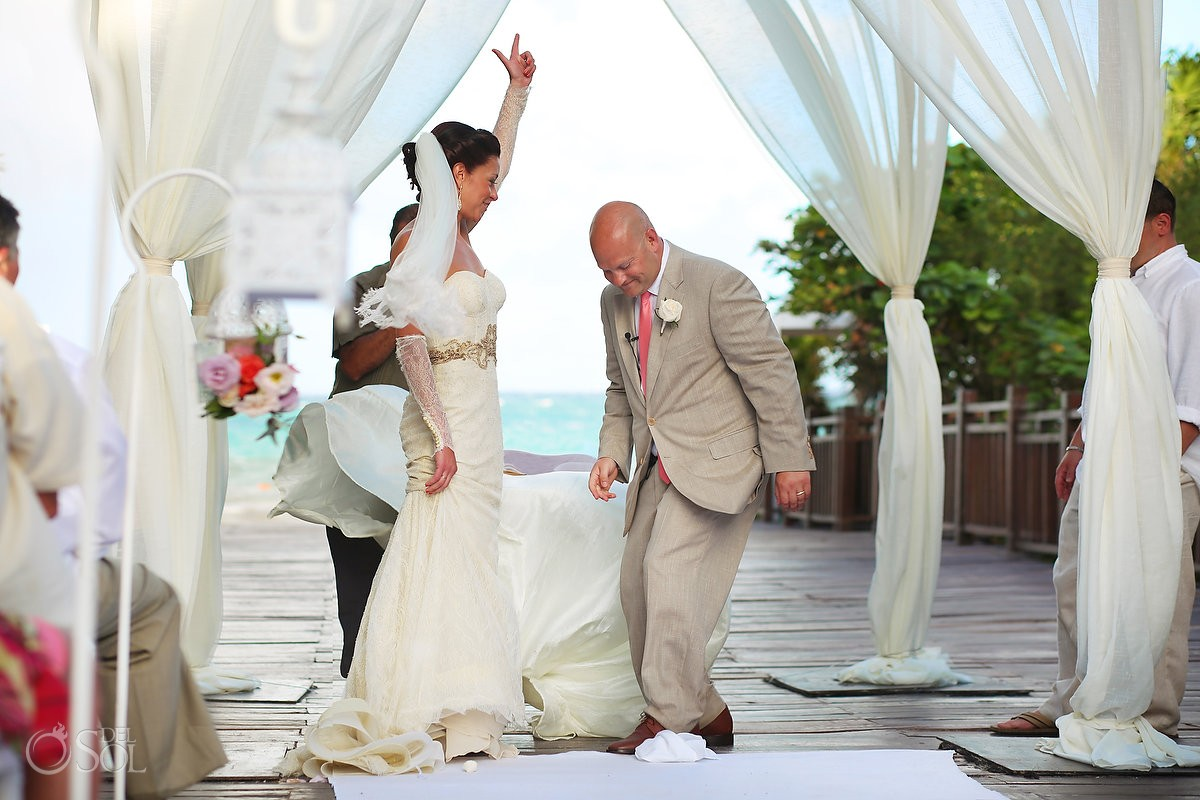 destination wedding photo bride and groom breaking glass mazeltov