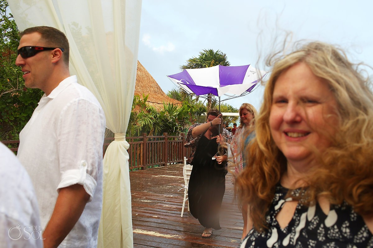 rainy wedding wedding recessional at paradisus playa del carmen
