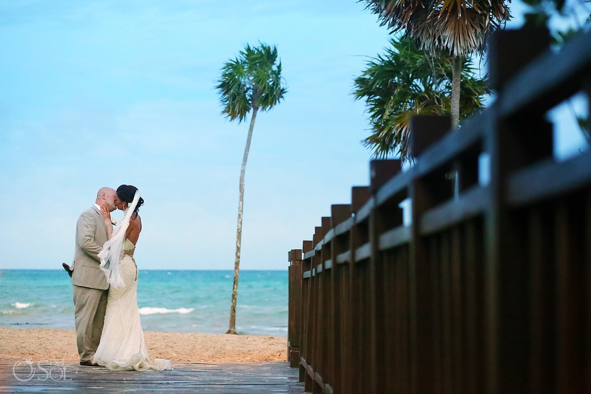 paradisus esmeralda bride and groom kiss at the beach in playa del carmen