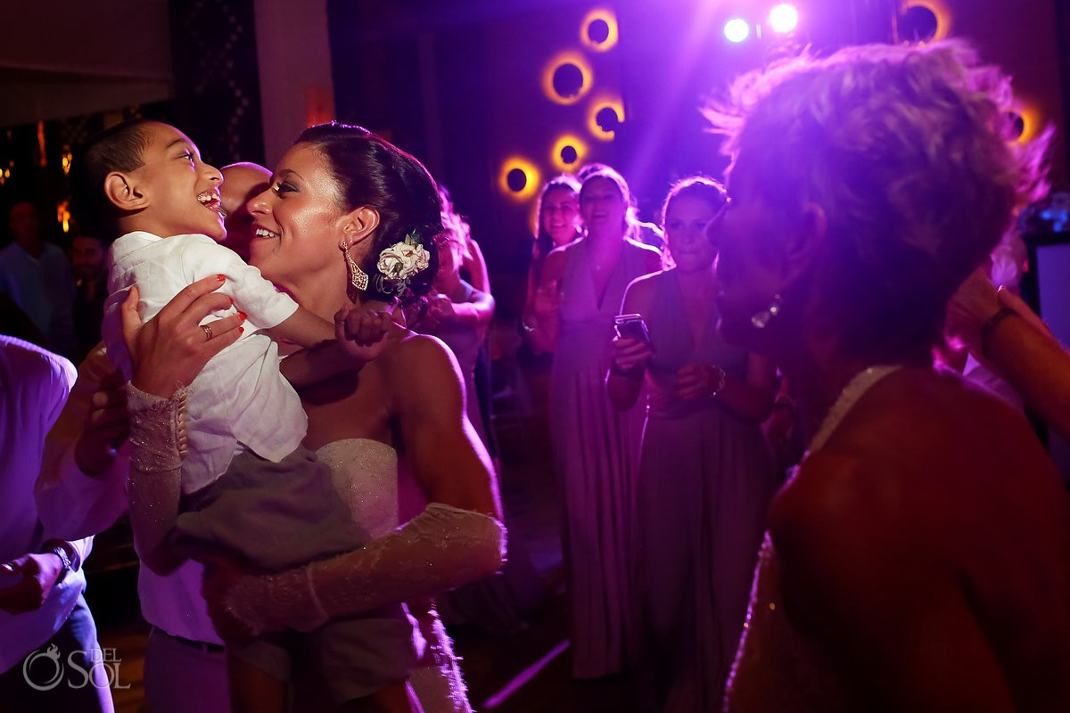 guests embracing at wedding reception at paradisus esmeralda