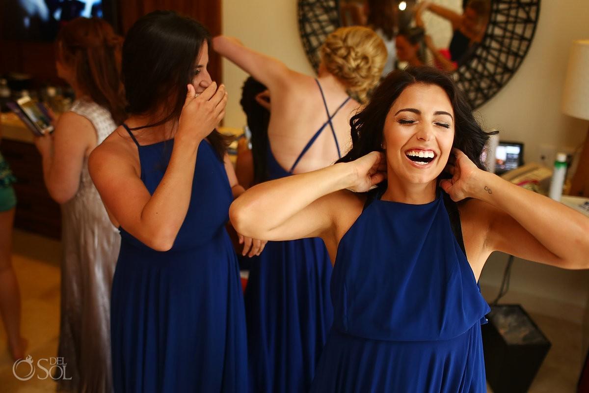 happy bridesmaid laughing wearing beautiful dark blue dress getting ready destination wedding Secrets Akumal, Riviera Maya, Mexico