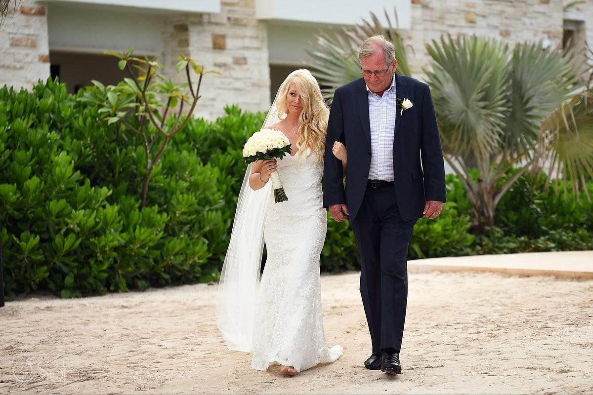 Emotional bride crying walking with father into beach wedding ceremony destination wedding Secrets Akumal, Riviera Maya, Mexico