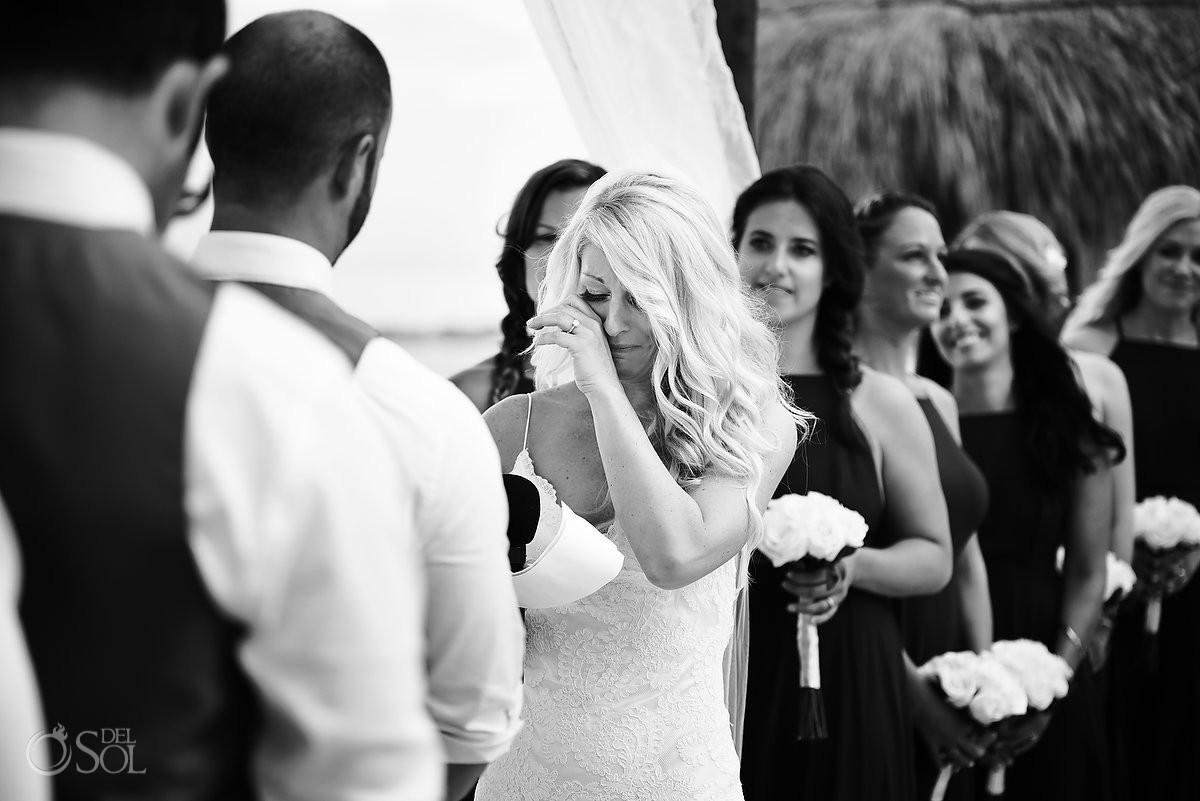 black and white wedding photo, emotional ceremony moment bride crying, beach wedding Secrets Akumal, Riviera Maya, Mexico