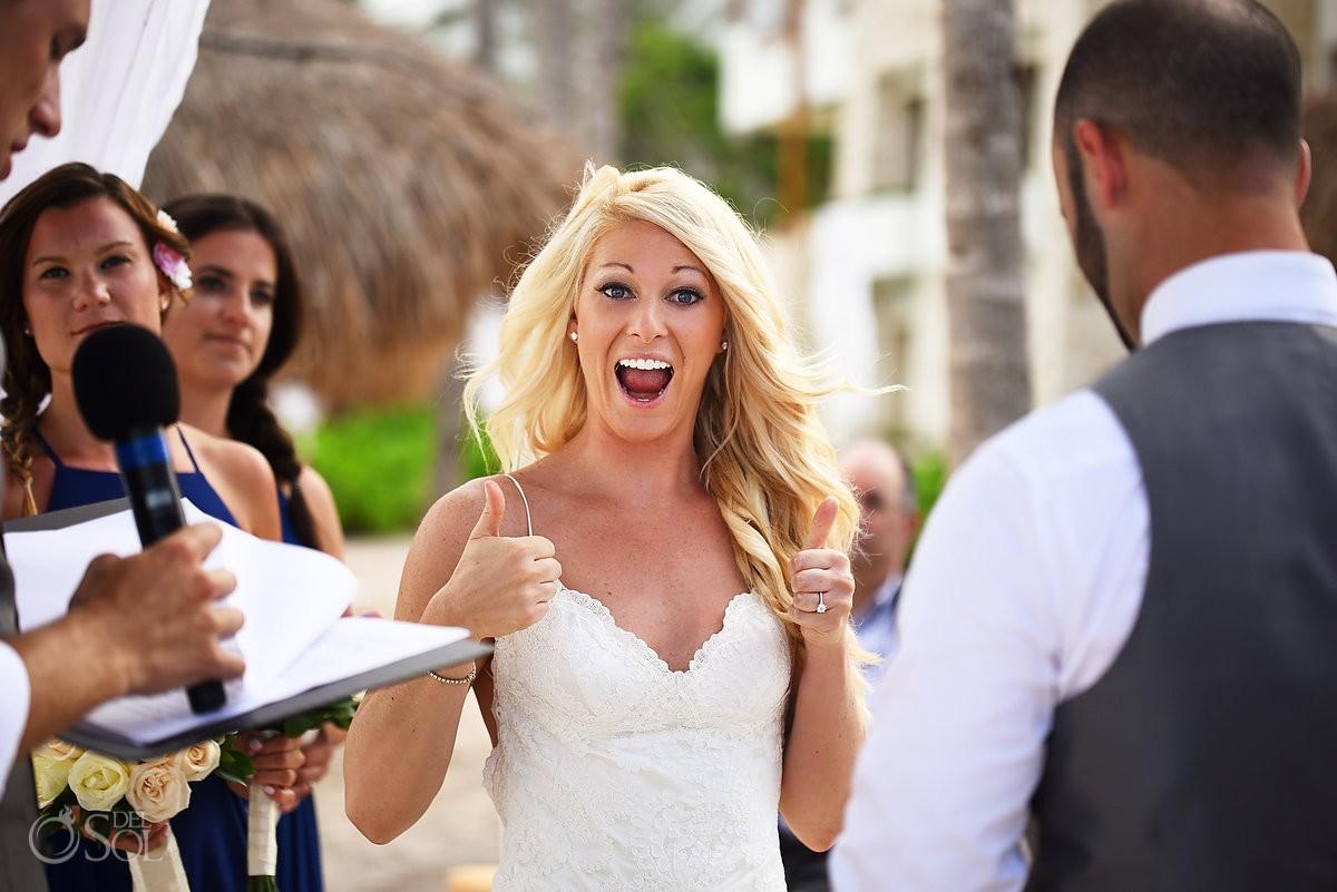 Bride gives double thumbs up, beach wedding Secrets Akumal, Riviera Maya, Mexico
