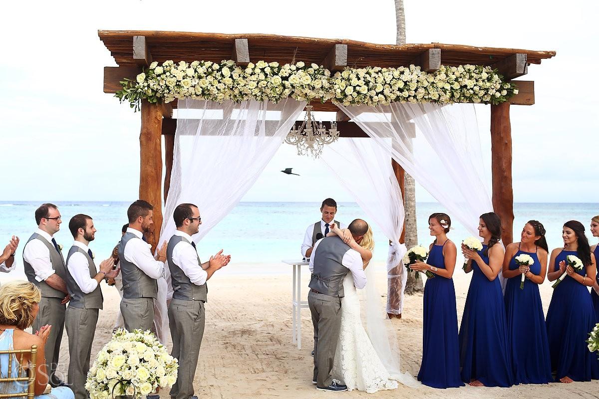 first kiss beach with a bird, wedding ceremnony Secrets Akumal, Riviera Maya, Mexico