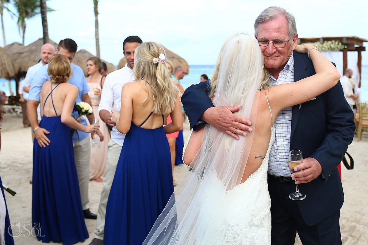 celebration hugs after beach wedding ceremony Secrets Akumal, Riviera Maya, Mexico
