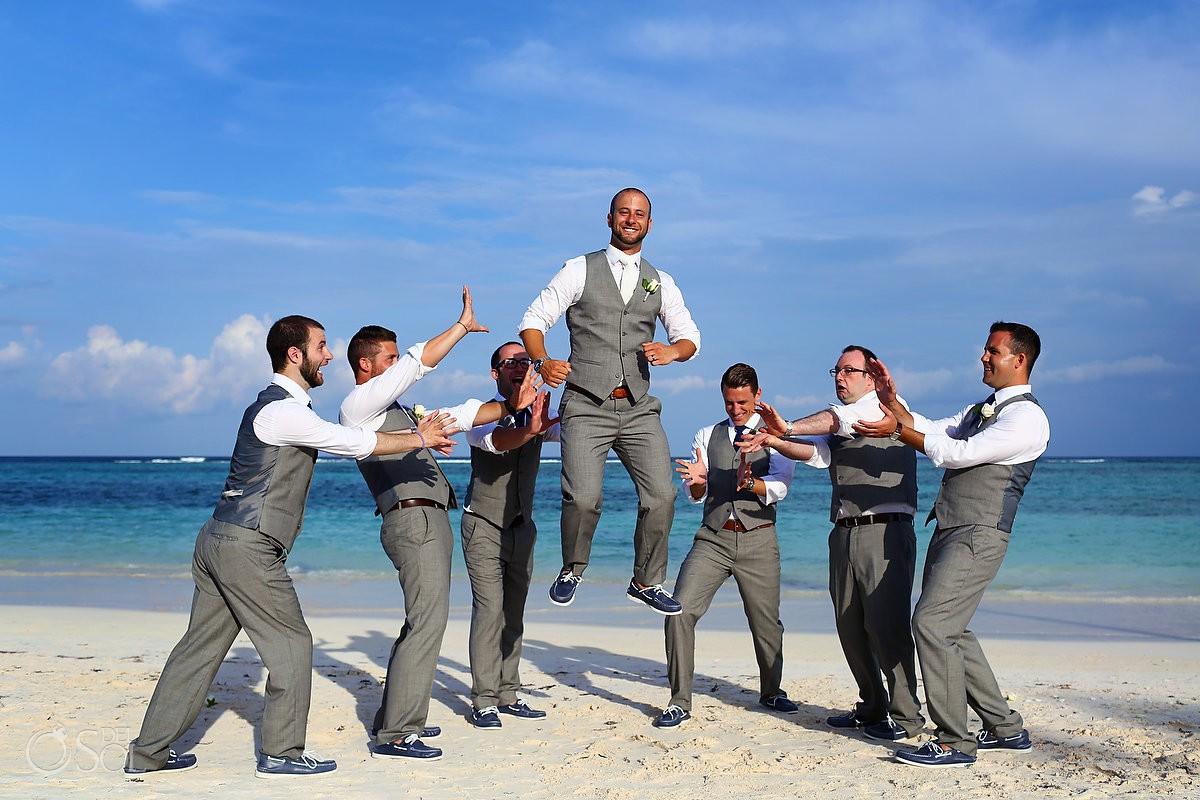 funny levitation groom groomsman bridal party photo idea destination wedding Secrets Akumal, Riviera Maya, Mexico