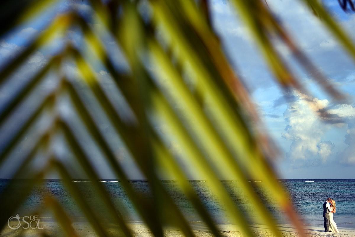 beach wedding portrait creative framing palm leaf Secrets Akumal, Riviera Maya, Mexico