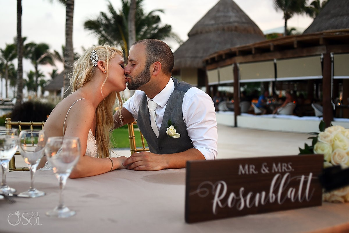 candid portrait bride groom kiss mr and mrs sign destination wedding reception Secrets Akumal poolside, Riviera Maya, Mexico