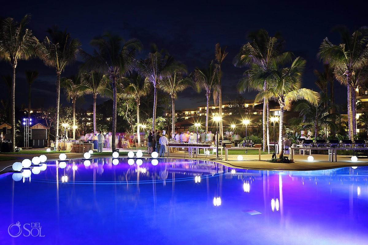 night time destination wedding reception Secrets Akumal poolside, Riviera Maya, Mexico