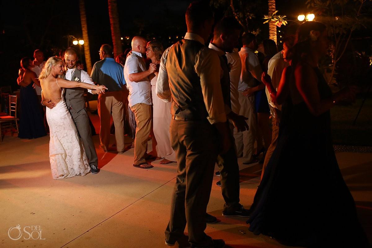 bride and groom dancing destination wedding reception Secrets Akumal poolside, Riviera Maya, Mexico