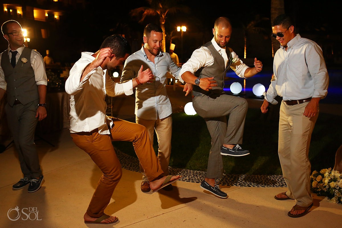 funny dancing picture destination wedding reception Secrets Akumal poolside, Riviera Maya, Mexico