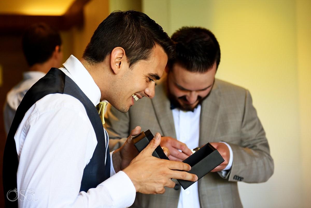 Groom opens wedding day gift, destination wedding getting ready Grand Hyatt Playa del Carmen Mexico