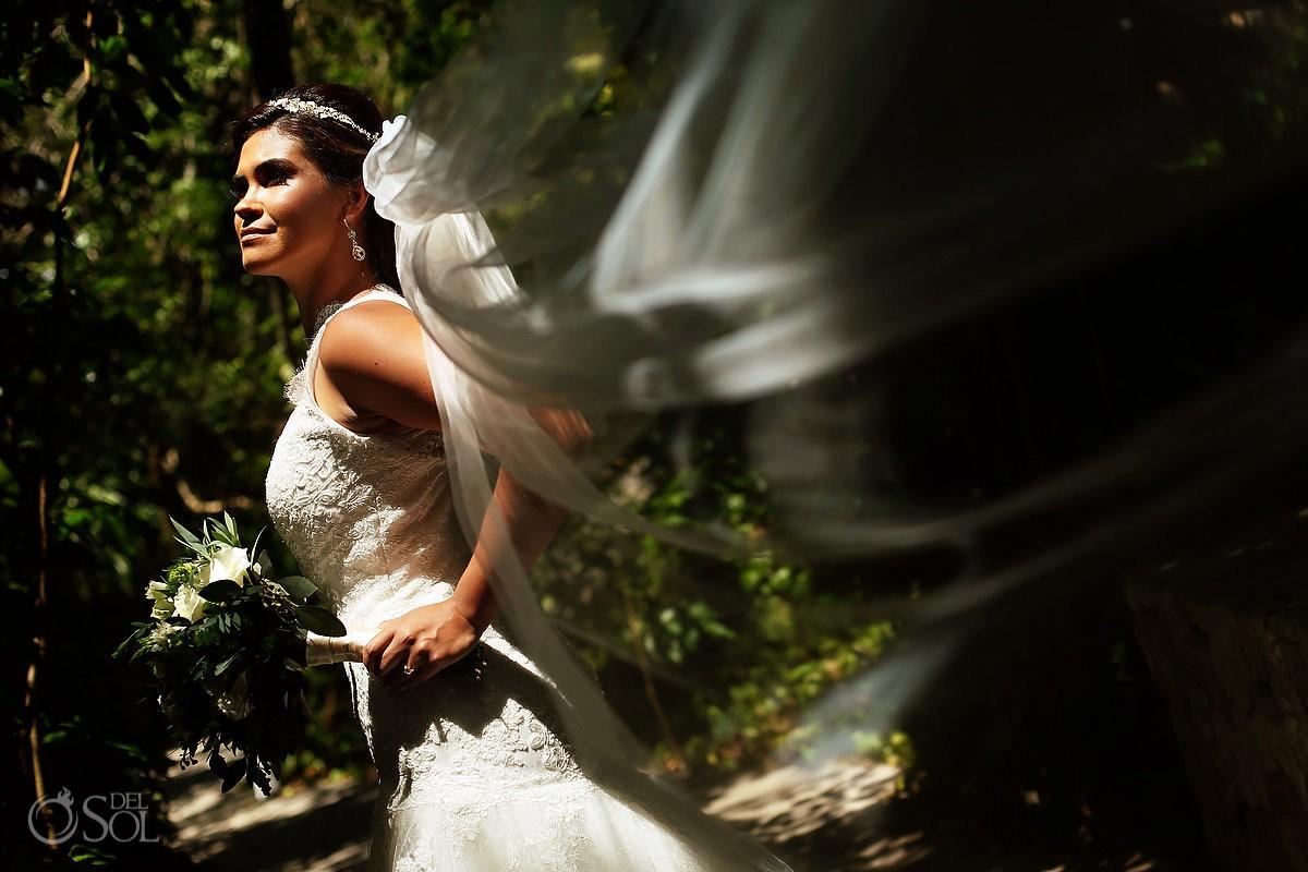 Beautiful bride portrait wearing Pronovias wedding dress and veil, Xcaret Park Playa del Carmen Mexico
