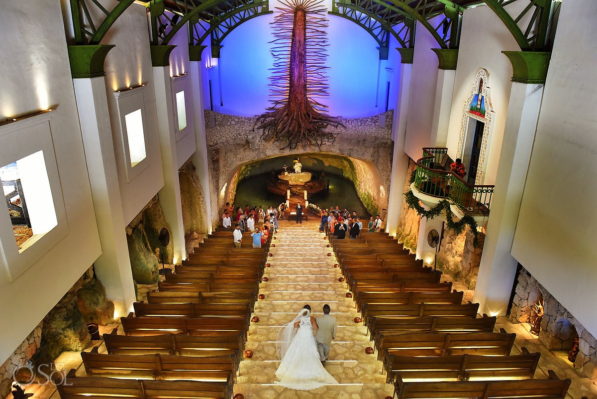 Bird's eye view bride entrance Catholic Wedding Ceremony Xcaret Chapel of Guadalupe cenote church, Playa del Carmen Mexico