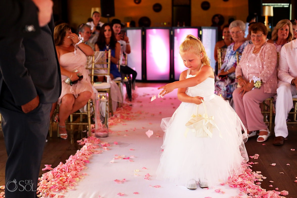 cute flower girl throwing petals, alternate rain wedding ceremony location Gabi Club Paradisus Playa del Carmen
