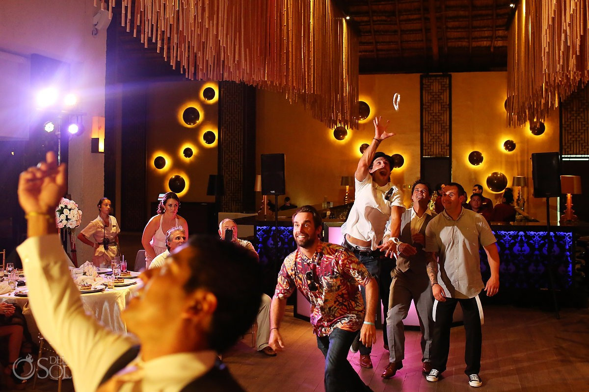 garter toss destination wedding reception Gabi Club Paradisus La Perla, Playa del Carmen, Mexico.