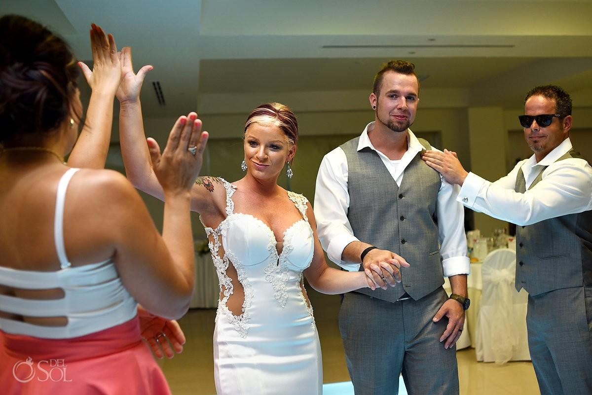 Destination wedding reception entrance high five Hyatt Zilara Ballroom Cancun Mexico