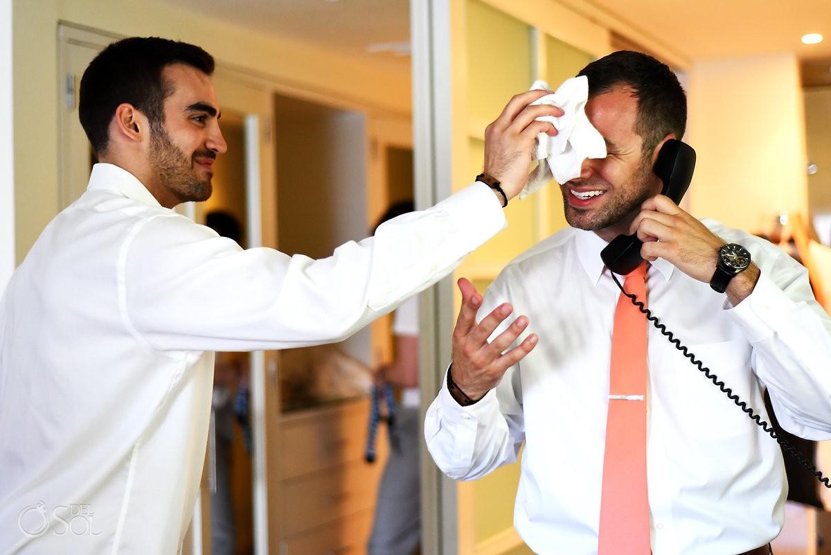 Funny wedding photo, groomsman mops groom's sweat, getting ready Destination Wedding Paradisus La Esmeralda